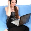 Young girl with notebook and headphones — Stock Photo