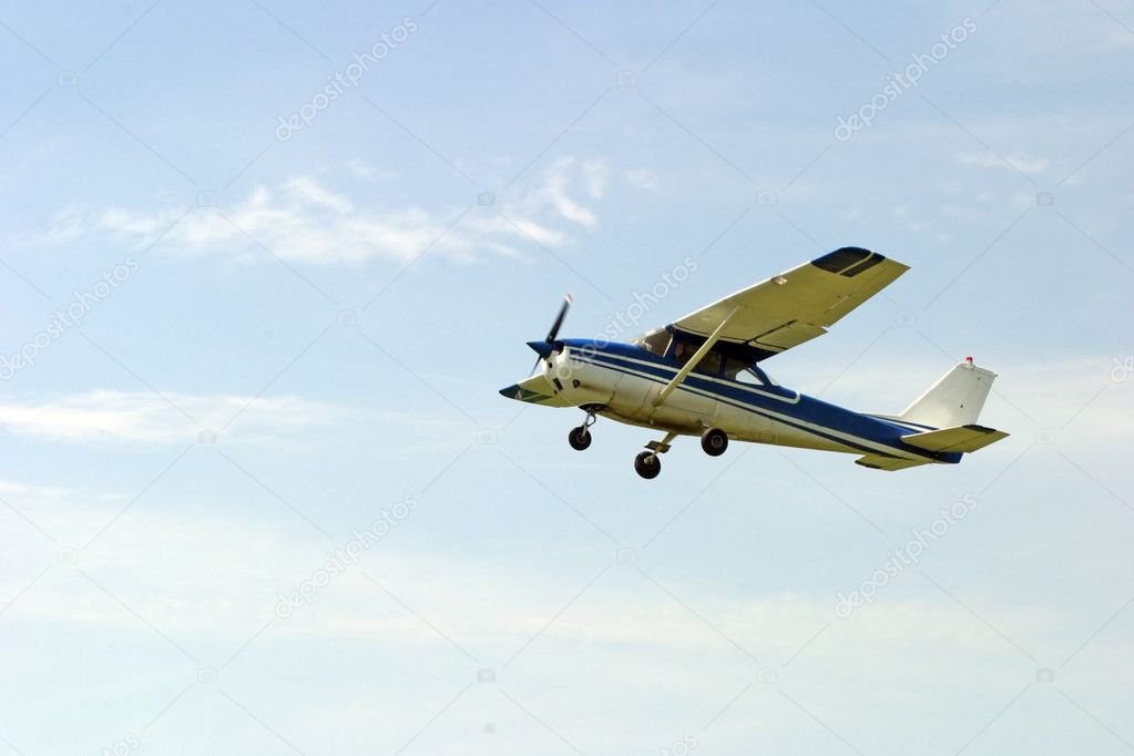 Agricultural plane is flying above horizon  Stock Photo #2864038