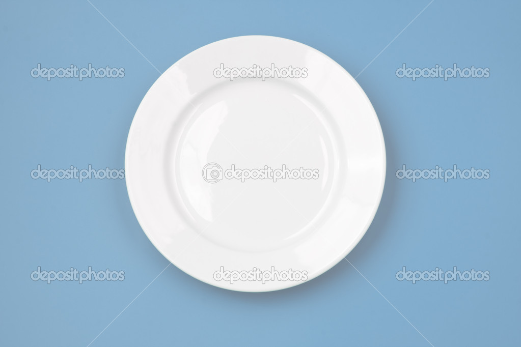 White round plate on sky blue background — Stock Photo #2788744