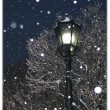 Lantern in snowing night — Stock Photo #2788705