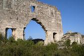 Wall of tumbledown monastery — Stock Photo