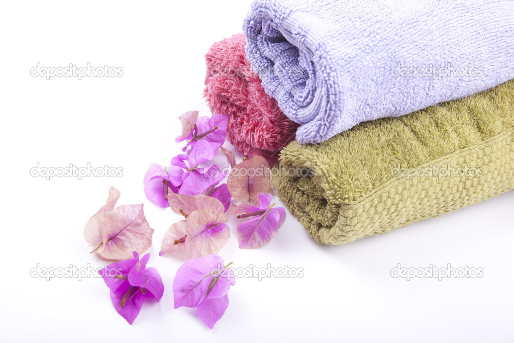 Spa and Wellness concept - rolled towel with bougainvillea flower — Stock Photo #3141122
