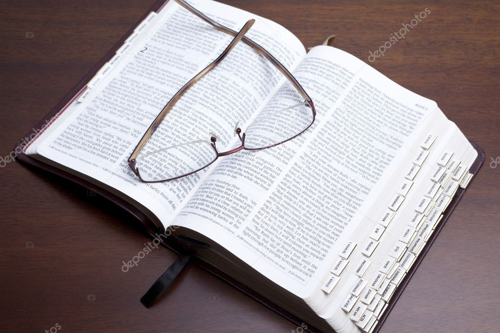 Reading glasses on top of open bible book  Stock Photo #3187289