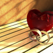Heart and two wedding rings - Foto Stock