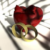 Heart and two wedding rings — Stock Photo