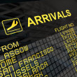 International Airport Arrivals  Board — Stock Photo