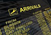 International Airport Arrivals Board — Stock Photo