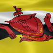 Bruneian flag in the wind - Stock Photo