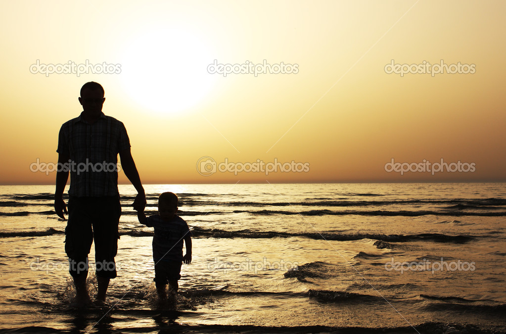 Father and son at sunset on the sea — Stock Photo #2873882