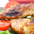 Stock Photo: Roasted chicken drumsticks and vegetables