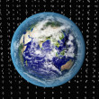Blue Earth in space with binary code - Stock Photo