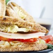 Fresh and delicious classic club sandwich with coffee - Stock Photo