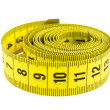 Stock Photo: Curled yellow measuring tape