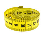 Curled yellow measuring tape — Stock Photo