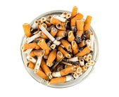 Cigarettes in an ashtray isolated — Stock Photo
