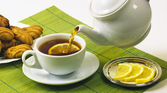 Lemon tea and biscuits in breakfast — Stock Photo