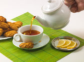 Lemon tea and biscuits — Stock Photo