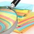 Magnifier enlarges the stack of sheets — Stock Photo