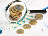 Charts and coins — Stock Photo