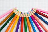 Pencils at the cellular background — Stock Photo