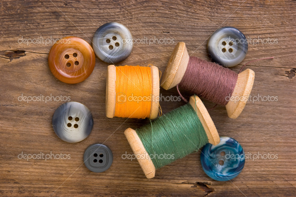 Sewing on the background of the old wooden walls — Stock Photo #4980395