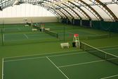 Indoor tennis court — Stock Photo