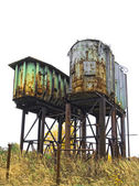 Two rusty old industrial barrels — Stock Photo