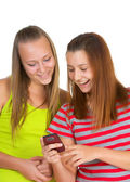 Two girls read messages on the phone — Stock Photo