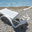 White chaise lounge on the beach — Stock Photo
