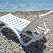 White chaise lounge on the beach — Stock Photo #5096758