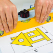 Drawing at home with construction tools - Stock Photo