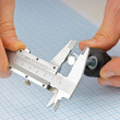 Caliper measures the detail - Stok fotoraf