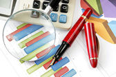 Graphs tables and documents — Stock Photo