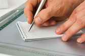 Write with a pen in a notebook — Stock Photo