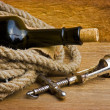 Old corkscrew with cork and bottle — Stock Photo #5109083