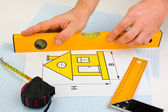 Drawing at home with construction tools — Stok fotoğraf