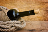 Bottle wrapped with rope — Stok fotoğraf