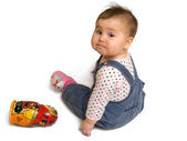 Sad baby boy and matreshka toy — Stock Photo