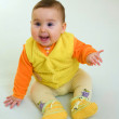 Happy baby in orange dress — Stock Photo
