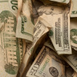 Crinkled us dollar bills closeup — Stock Photo