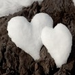 Two snow hearts on rock — Stok fotoğraf