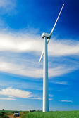 Wind turbine and small car — Stock Photo
