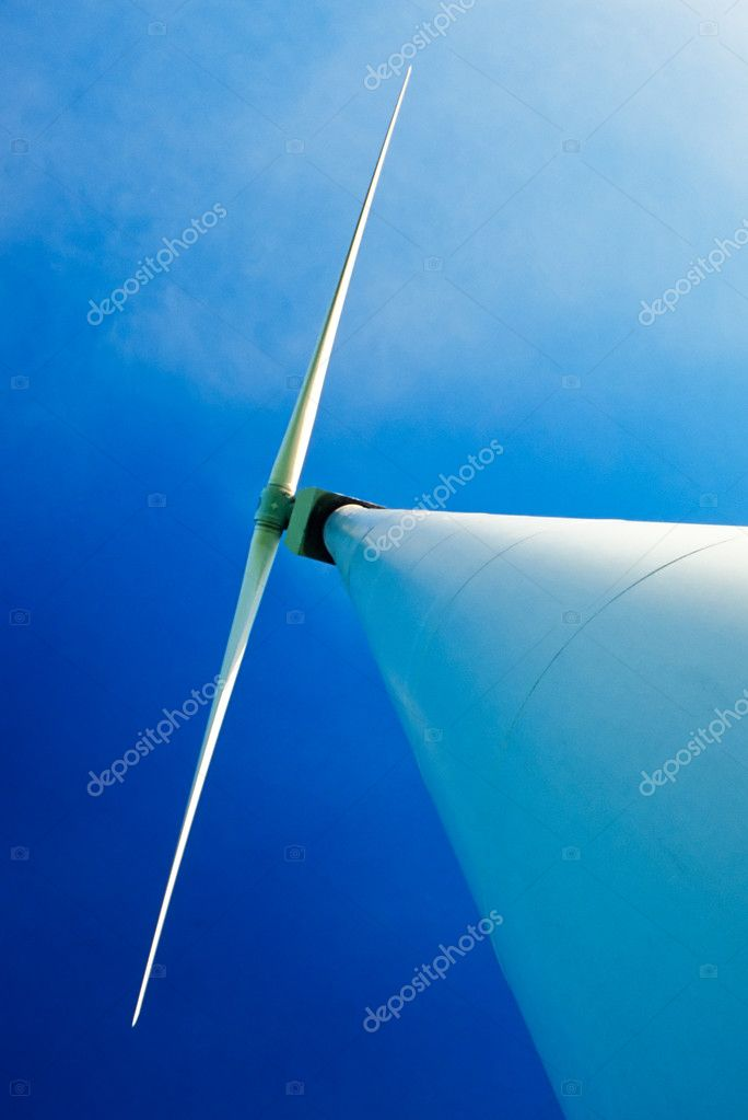 Wind turbine with dual wing rotor, shot from underneath at base of tower — Stock Photo #3423603