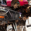 Vehicles rust on scrapyard — Stockfoto