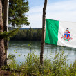 Stock Photo: Yukon flag in front of Yukon River