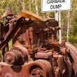 "Stock Photo: Big engine block and sign ""Garbage Dump"""