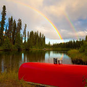 Canoe and Rainbow — Stock Photo