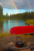 Canoe, Campfire and Rainbow — Stock Photo