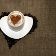 Coffee with heart on hessian — Stock Photo