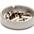 Dirty ashtray full of cigarette butts and matches — Stock Photo